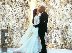 Loving the rose wall behind Kim and Kanye! Will this be the next big trend? Kim Kardashian and Kanye West wedding photo - Hollywood brides ...