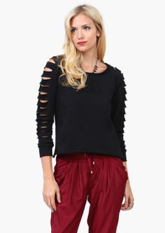 When they said the '80s were coming back, I didn't think they meant the worst of the 80's.  Hammer pants and shredded clothes - can parachute pants be far behind?