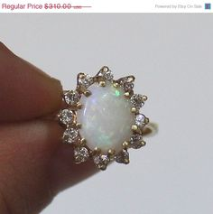 I think this is just like the opal ring my mom once had. Love it.