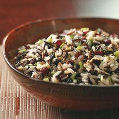 Brown and Wild Rice Salad Recipe -This side dish, developed by the Light & Tasty Test Kitchen, is twice as nice since it stars both brown and wild rice! Tangy raspberry vinegar complements the nutty flavor of the rice, while dried cranberries provide unexpected bursts of sweetness.