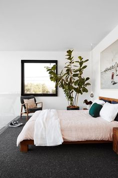 Bedroom from a 19th-century corner shop in Melbourne's inner-north that has been dramatically transformed with a sleek extension and mid-century modern style.