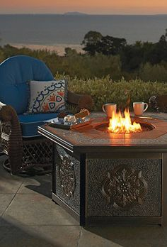 Warm your outdoor conversation area with flickering firelight!