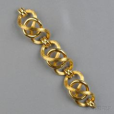 18kt Gold Bracelet, composed of engraved figure-eight and plain polished links, 62.4 dwt, lg. 7 1/2 in.