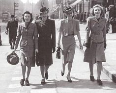 Picture of women in daytime clothing post WWII. You can see the influence of military uniforms shown in their clothing like the belted blazer on the woman on the far right. We also see the bolero jacket that became popular during this time period.