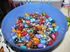 reusing plastic bottles to make beads  I wanna do this for Bean and Ian to make things!!!
