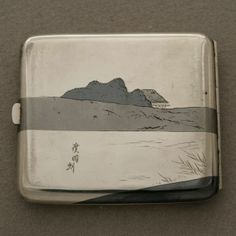 Japanese mixed metal cigarette case, ( can be used for business cards or credit cards) Retailed by K. Uyeda renowned jeweler from the Imperial Hotel in Tokyo Japan. Silver, copper and brass.