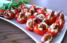 Goat Cheese–Stuffed Peppadews...I didn't do the pecans, and I dripped a balsamic reduction on top of them after they came out of the oven, a la Macoroni Grill...YUM :)