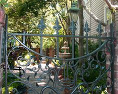 Charleston…an open gate means you are welcome to enter and meander through the garden; however, do not try to enter a garden with a closed gate. Charleston Gardens, Charleston Sc, Welcome Design, Gate Way, Beautiful Home Gardens, Wrought Iron Gates, Private Garden, Garden Gates, Garden Inspiration