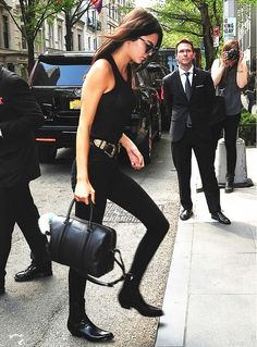 fitted black tank top + black skinnies + black ankle boots + structured black bag + thick belt