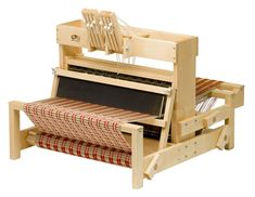 Table looms are great for classroom use, workshops, sampling, and small  projects. They are ideal for learning about four- and eight-shaft pattern  weaving, since the direct tie-up through the hand levers allows for  infinite experimentation.  Schacht table looms are expertly crafted of the finest hard maple and built  for maximum structural stability.  Fine-toothed nylon gears on both the warp and cloth beams, which allow  precise tension control. Our front-mounted levers make shaft…