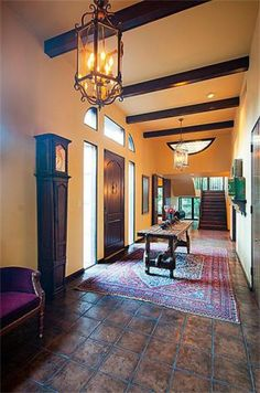 The foyer ceiling features exposed wood beams, while the room itself is spacious enough to allow for a sitting area. Photo: Realtor.com / HC