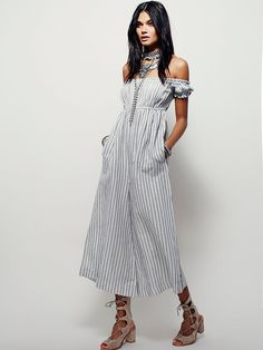 I Can't Get Over This Romper | In a semi-sheer, lightweight, and striped fabrication, this wideleg romper features an empire waist with an elastic band for an easy fit.  Off-the-shoulder style with an elastic band at the bust for effortless styling.  Hip pockets.