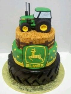 Awesome birthday cake idea, but I'd just buy a toy J.D. tractor for the top!  Hmmm...Which son will I make this cake for?