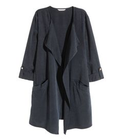 H&M: Lyocell-blend Jacket. Dark blue. Long jacket in a soft Tencel® lyocell blend with draped lapels, front pockets, and long sleeves with roll-up tab and snap fastener. Unlined.