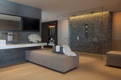 Modern Master Bathroom with Garden State Tile Sand Graffiatio Linear, frameless showerdoor, Rain shower, Corian counters
