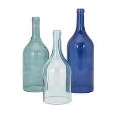 Out of the blue: A trio of glass bottles in complementary hues. Includes: Three (3) blue cloche bottles Materials: 100-percent glass Item weight: 10.5 pounds Dimensions: 14-16-18 inches high x 5.5-5.7