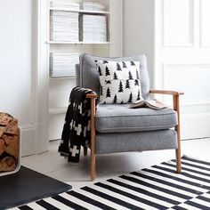 .a mid century armchair. Can't get classier than the slim wood frame-soft textile seating combination of the 50ies furniture. Love the soft grey hue on this one and the geometric black and white patterns on the textiles around it.
