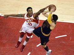 233de4149 Atlanta Hawks guard Jeff Teague (0) defends the shot of Cleveland Cavaliers  guard Matthew