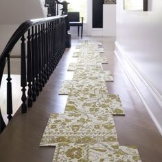 Want to soften up the wooden floor in your hallway? You don't need to completely cover up that gorgeous floor.
