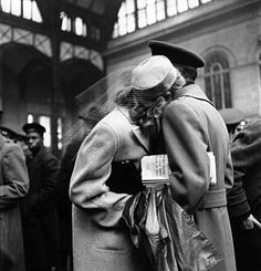 Alfred Eisenstadt: Couple in Penn Station sharing farewell embrace before he ships off to war during WWII, 1943