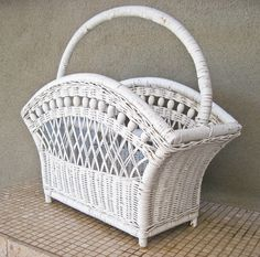 $48. Love the little wooden balls on the trim of this large wicker magazine holder, as well as the curved flared shape No missing wicker but slight