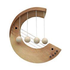 a door harp- the balls hit the strings when the door moves