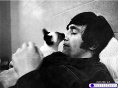 Awww, John with a kitty. Truly had love in his heart for all, great and small.