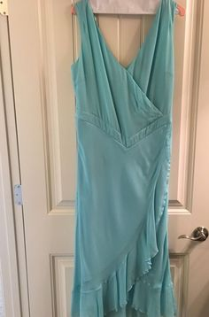 In like new condition. No stains or tears. Dry-cleaned, ready to wear. Light aqua/turquoise. V neckline front and back, sleeveless. Hidden side zipper. Banded empire waist. Ruffle bottom. | eBay!