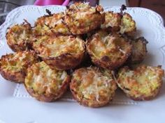 "Zucchini Parm Tots"" 2 cups squash and/or zucchini, peeled 2 eggs ½ small onion, grated 1 cup Parmesan cheese, grated 2/3 cups plain breadcrumbs ½ tsp garlic powder salt and pepper"