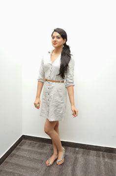 Cute Girl Sakshi Chowdary in White Mini Dress at Potugadu Movie Platinum Disc Function IndianRamp.com | Indian Ramp