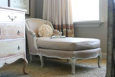 PAINTED upholstery.  Funny, I was just thinking the pale pink damask chaise in the guest room needed a make over...hmmmm