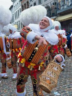 Top 10 Carnival traditions: Gilles throwing oranges at Binche Carnival, Belgium. Photo by Carnaval de Binche