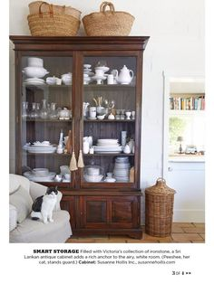 I love brown and white and the simple baskets atop help round out the room and give it a more casual feel. This is what I meant about how to lighten up a dark cabinet. The Tricks You Need To Know For Decorating Above Cabinets Kitchen Decorating, Decorating Ideas, Decorating Baskets, Decor Ideas, Craft Ideas, Deco Buffet, Above Cabinets, China Cabinets, Cupboards