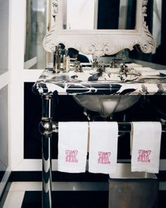 Monogrammed towels and a great way to personalize your space.   http://domino.com