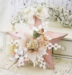 Pink star decorated with white decor and vintage style angel. Can be used alone or as a topper.