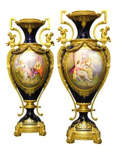 A PAIR OF ANTIQUE SEVRES STYLE TWO HANDLED VASES WITH BRONZE MOUNTS  Late 19th Century