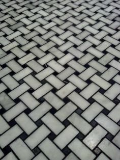 basketweave tile flooring with black grout. We tried the black grout, but it bled into the white tile and looked terrible. Ended up using gray grout instead.
