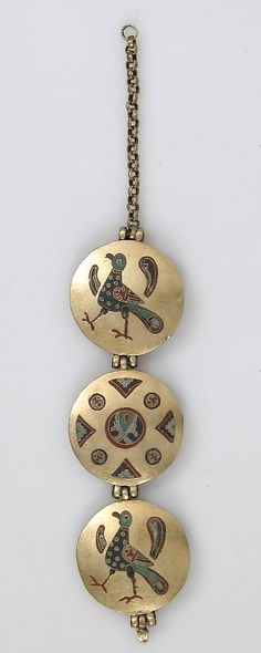 Chain with Birds and Geometric Motifs    Date:    1000–1200  Geography:    Made in, Kiev (probably)  Culture:    Kievan Rus'  Medium:    Cloisonné enamel, gold  Dimensions:    Overall (with chain): 6 x 1 x 3/16 in. (15.3 x 2.5 x 0.5 cm) Overall (without chain): 4 x 1 x 3/16 in. (10.1 x 2.5 x 0.5 cm) Overall (with 17.190.681): 10 3/8 x 1 x 3/16 in. (26.4 x 2.5 x 0.5 cm)  Credit Line:    Gift of J. Pierpont Morgan, 1917  Accession Number:    17.190.682
