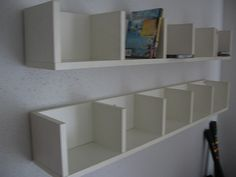 cut DVD bookshelves and hang on wall; $40 to $50 for Ikea version. Might be too tall though. Need to measure... again...