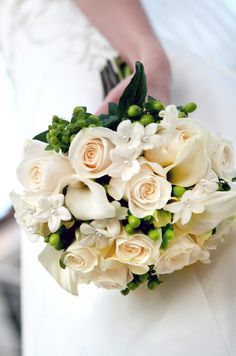 Like this bouquet! A soft cream bouquet is made of Calla lilies, roses and stephanotis blossoms with tiny pearl pins. Small Wedding Bouquets, Winter Wedding Flowers, Bride Bouquets, Bridal Flowers, Flower Bouquet Wedding, Rose Bouquet, Summer Wedding, Wedding Types, Lily Wedding