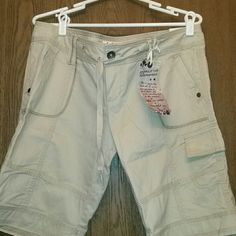 L.E.I LADIES CARGO SHORTS . MUST SELL TODAY! LEI LADIES BEIGE/TAN CARGO SHORTS.  ASHLEY TROUBLE BRAND NEW IN A SIZE 15. THEY HAVE A DRAWSTRING, ZIPPER AND BUTTON FRONT CLOSURE.  THERE ARE POCKETS ON THE LEGS, THE BACKSIDE AS WELL AS FRONT HIDDEN POCKETS.  THEY ARE 100% COTTON. THEY COME FROM A SMOKE-FREE AND PET-FREE HOME! lei Shorts Cargos