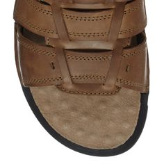 These tan sandals from Hush Puppies provide everyday comfort. Designed with genuine leather, they feature a woven upper strap and a flexible footbed.