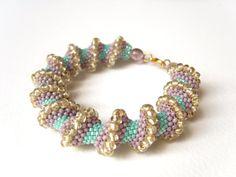 Spiral Beaded Bracelet  Bead Woven Bracelet by JewelleryByJora,