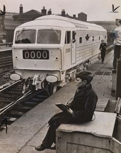 Young train spotter at station with the ghost train in background Electric Locomotive, Diesel Locomotive, Steam Locomotive, Time Travel Machine, Heritage Railway, Rail Transport, Old Trains, British Rail, Electric Train
