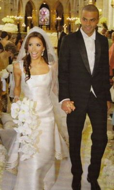Eva Longoria tied the knot with Tony Parker in a couture Angel Sanchez silk ivory gown. This one of a kind dress featured a scoop back and long train.