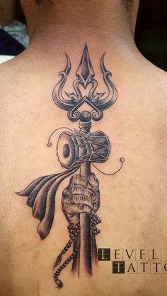 Trishul tattoo done by Billu tattoo at level ink tattoos