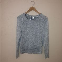 Silver H&M sweater Beautiful metallic silver sweater size small can fit a medium good condition H&M Sweaters Crew & Scoop Necks