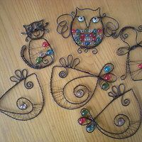 Beaded wire cat and birds