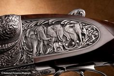 Holland & Holland built the first .700 Nitro Express rifles and this Philippe Grifnee engraved .700 double rifle, featuring deeply carved African scenes incorporating elephants as the primary subject, can fire a 1000-grain projectile that can generate as much as 15,000 ft-lbs of energy.