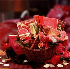 Heart To Heart Couples Romance Gift Basket    Massage oil, silk bag with rose petals, a set of 3 votive tea lite candles, acrylic champagne glasses, sparkling cider, An easy listening Instrumental romance CD, The Lover's Guide book, Sweetheart chocolate cake, vanilla caramels, Belgian truffles, Almond Roca, Kettle Fresh Fudge, Ghirardelli chocolate bar, Chocolate and toffee cookies and a for lovers only card game where everyone's a winner.  SHOP NOW: www.KimsLabellabaskets.com
